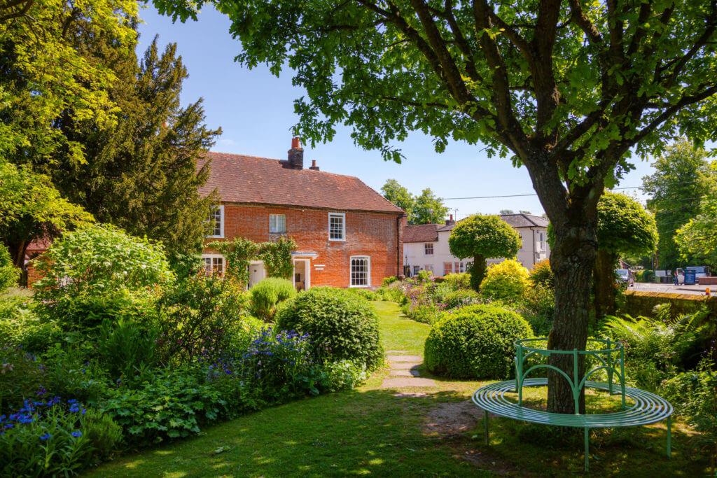 Round bench at formal garden of Chawton Cottage, an independent museum of novelist Jane Austen