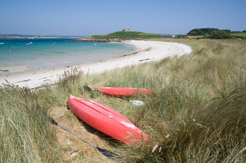 Kayaks on old grimsby beach on tresco