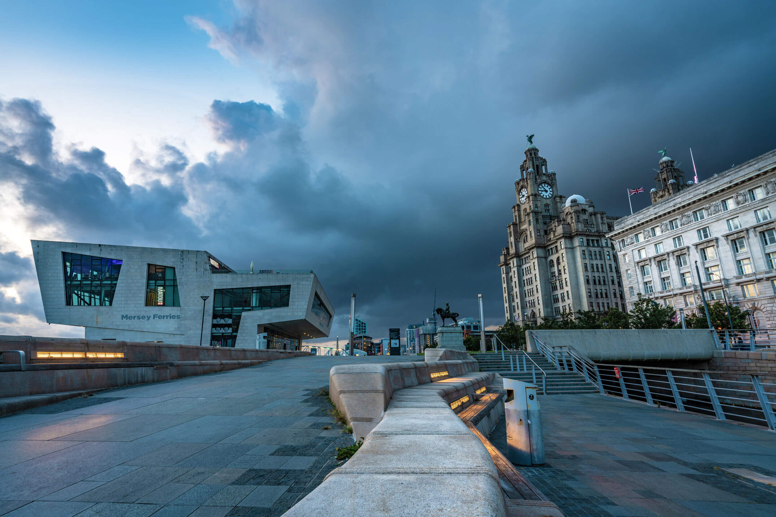 LIVERPOOL, UNITED KINGDOM - AUGUST 11: This is an evening view of the waterfront area and historic city buildings on August 11, 2019 in Liverpool