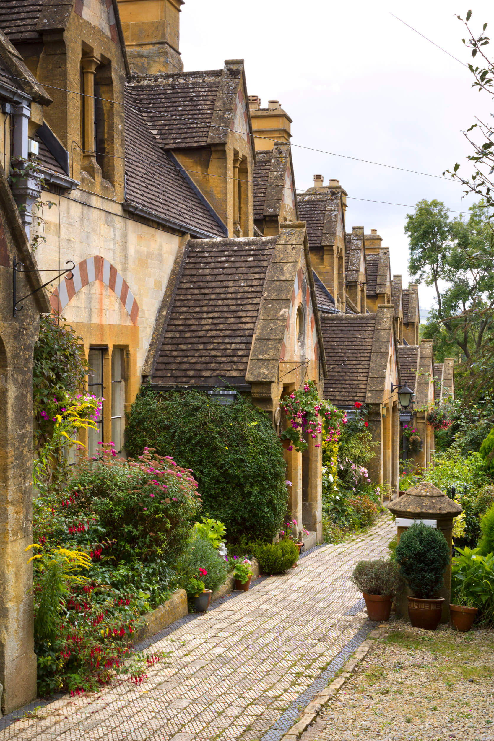 A row of picturesque Cotswold cottages in Winchcombe, Gloucestershire, UK.