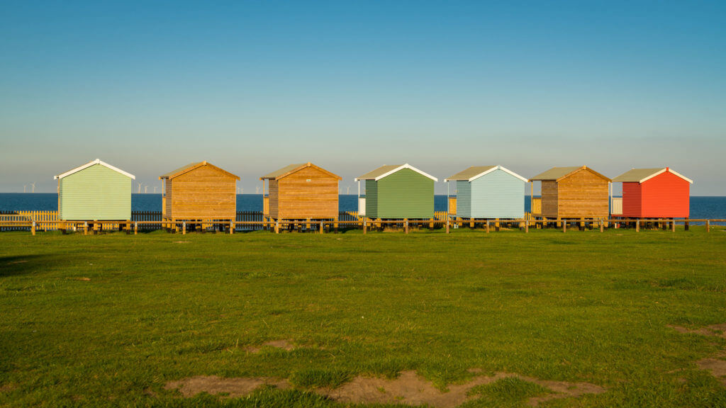 Beach huts with sea view in Leysdown-on-Sea, Isle of Sheppey, Kent, England, UK