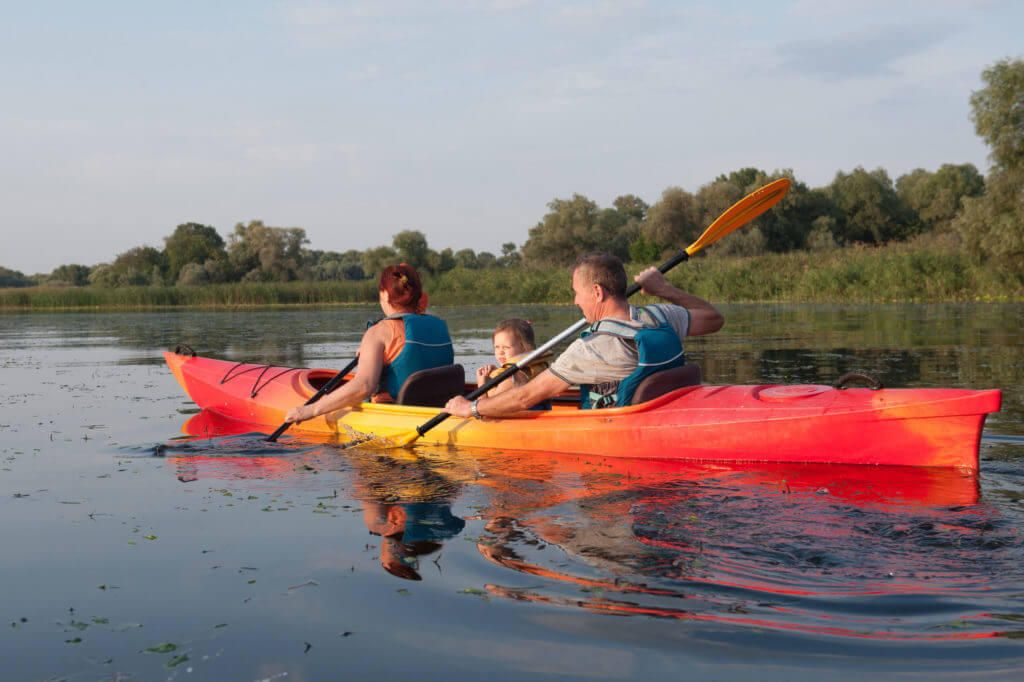 Family in a kayak on a water walk