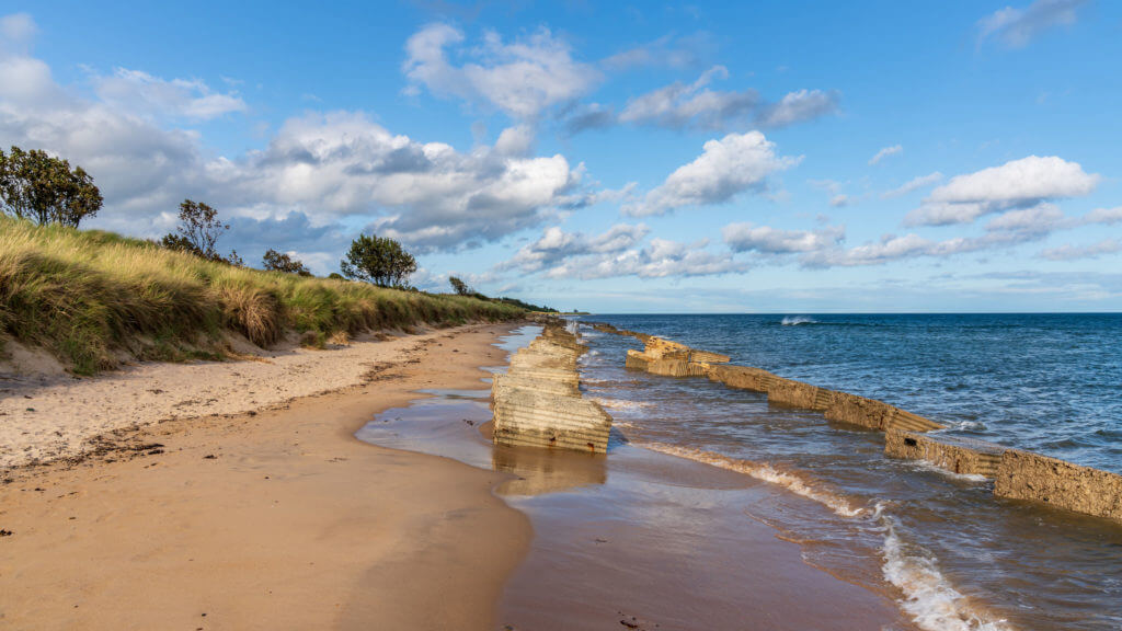 North Sea Coast in Alnmouth in Northumberland, England, UK - with some anti-tank blocks from the second world war on the beach