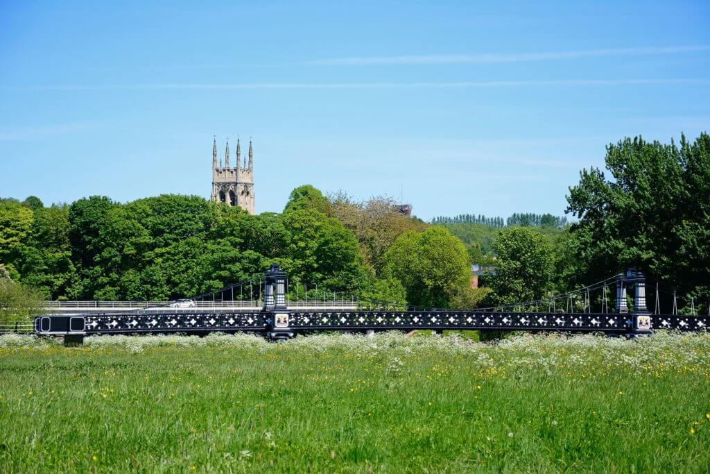 View of the Ferry Bridge also known as the Stapenhill Ferry Bridge with St Peters church tower to the rear and a meadow in the foreground, Burton upon Trent, Staffordshire, England, UK, Western Europe.