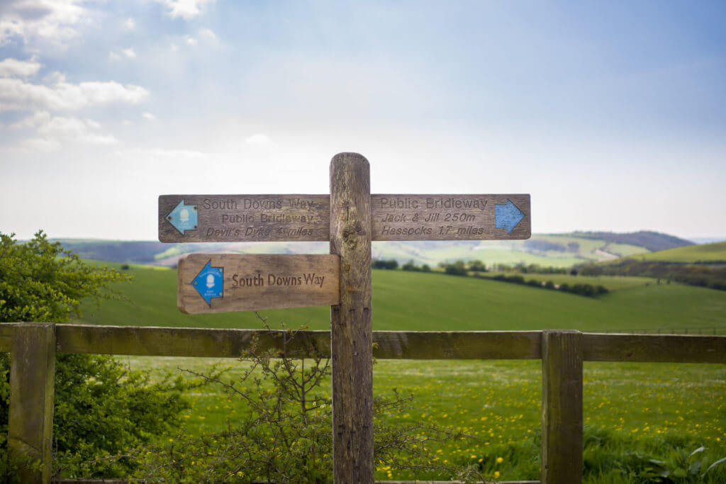A sign post for the South Downs Way footpath near the Clayton Windmills Sussex UK
